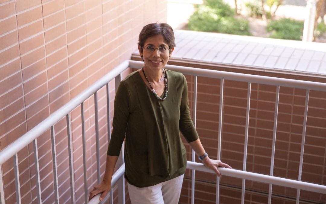 Chaitali Chakrabarti poses in the stairwell of the Goldwater Center
